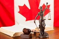 Scales of Justice in front of a Canadian Flag